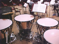 Timpani drums behind orchestra