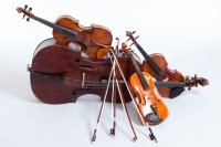 Image of string instruments resting against each other