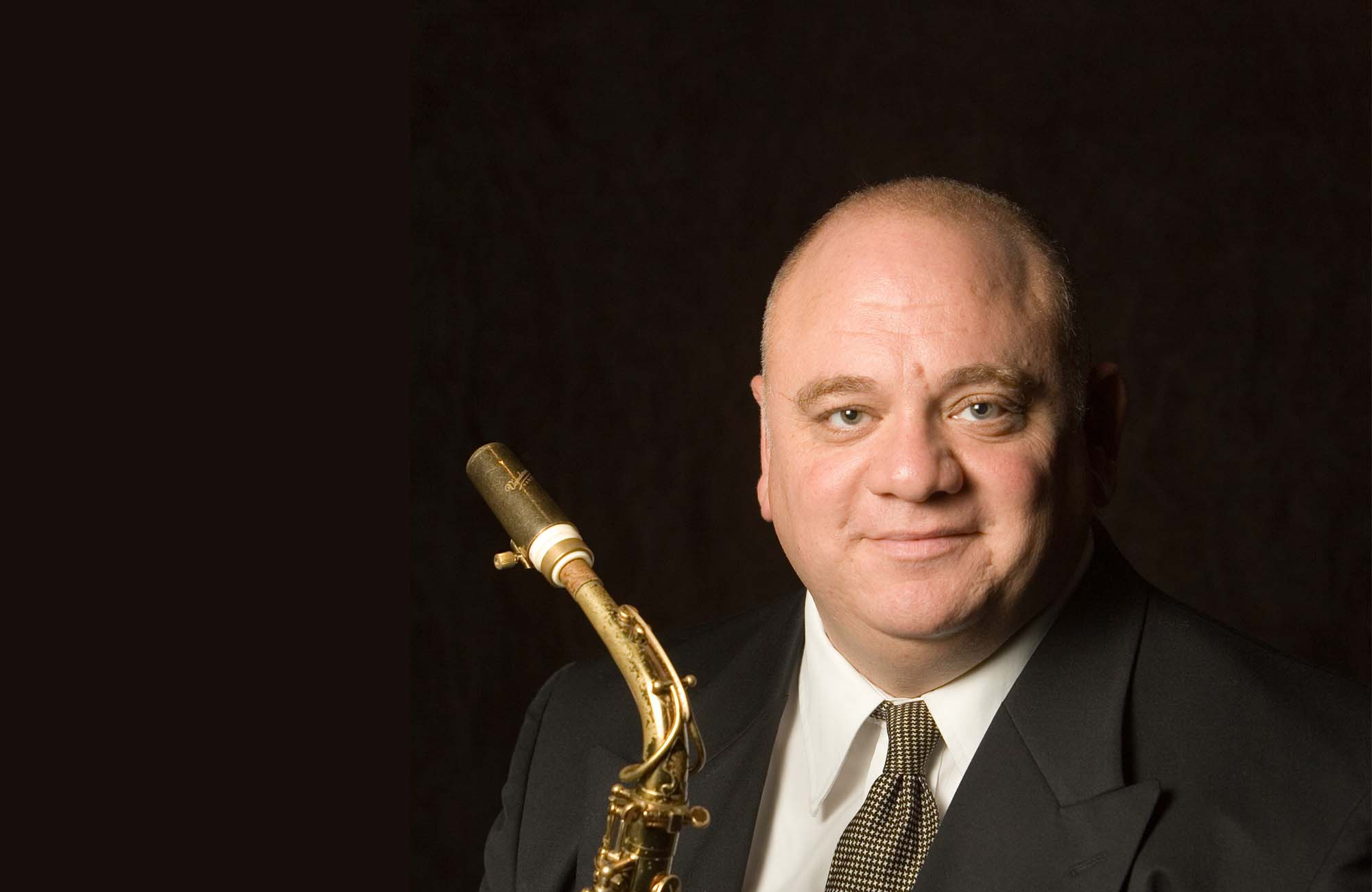 Joe Carello holding Saxophone